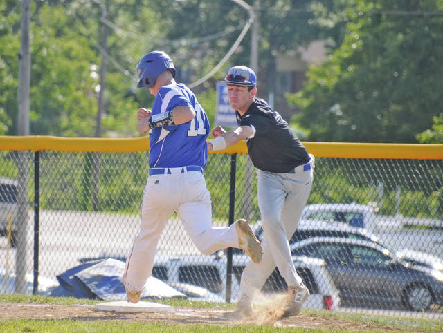 b8a41c67 Mason County's Jake Swolsky tags out Bracken County's Logan Sorrell at  first base, Monday, during the 39th District Baseball Tournament at Mason  County.