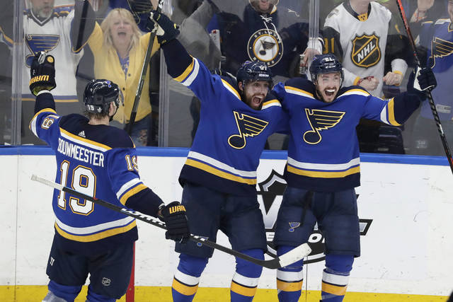5c2531b4a7a ... David Perron (57) and Tyler Bozak (21) celebrate after Bozak scored a  goal against the San Jose Sharks during the third period in Game 6 of ...