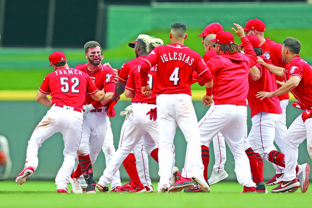 7da7e9cd Cincinnati Reds' Jesse Winker, left, celebrates with teammates after  hitting the game-winning RBI-single in the ninth inning against the Houston  Astros, ...